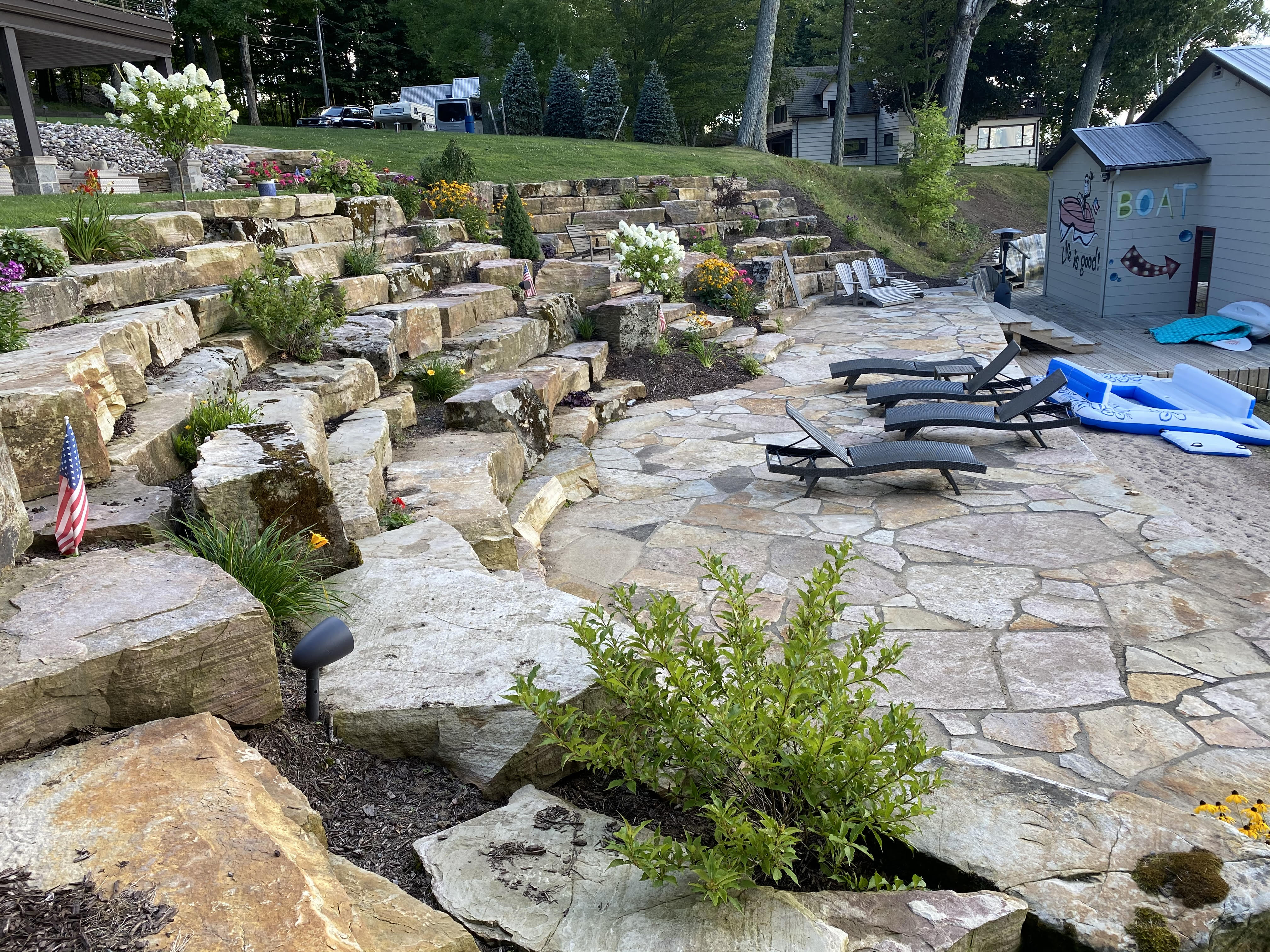 Boulder Retaining Wall with Flagstone Patio