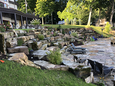 Flagstone Patio with a Boulder Terrace and Mortared Sandstone Seawall