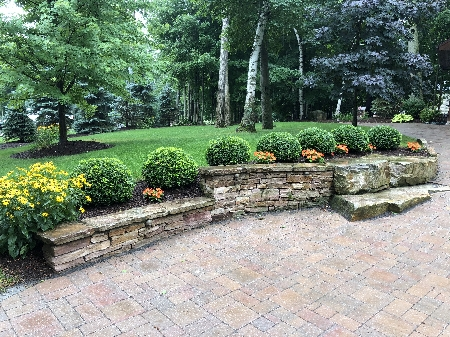Natural Stack Stone Walls and Borders with Plantings