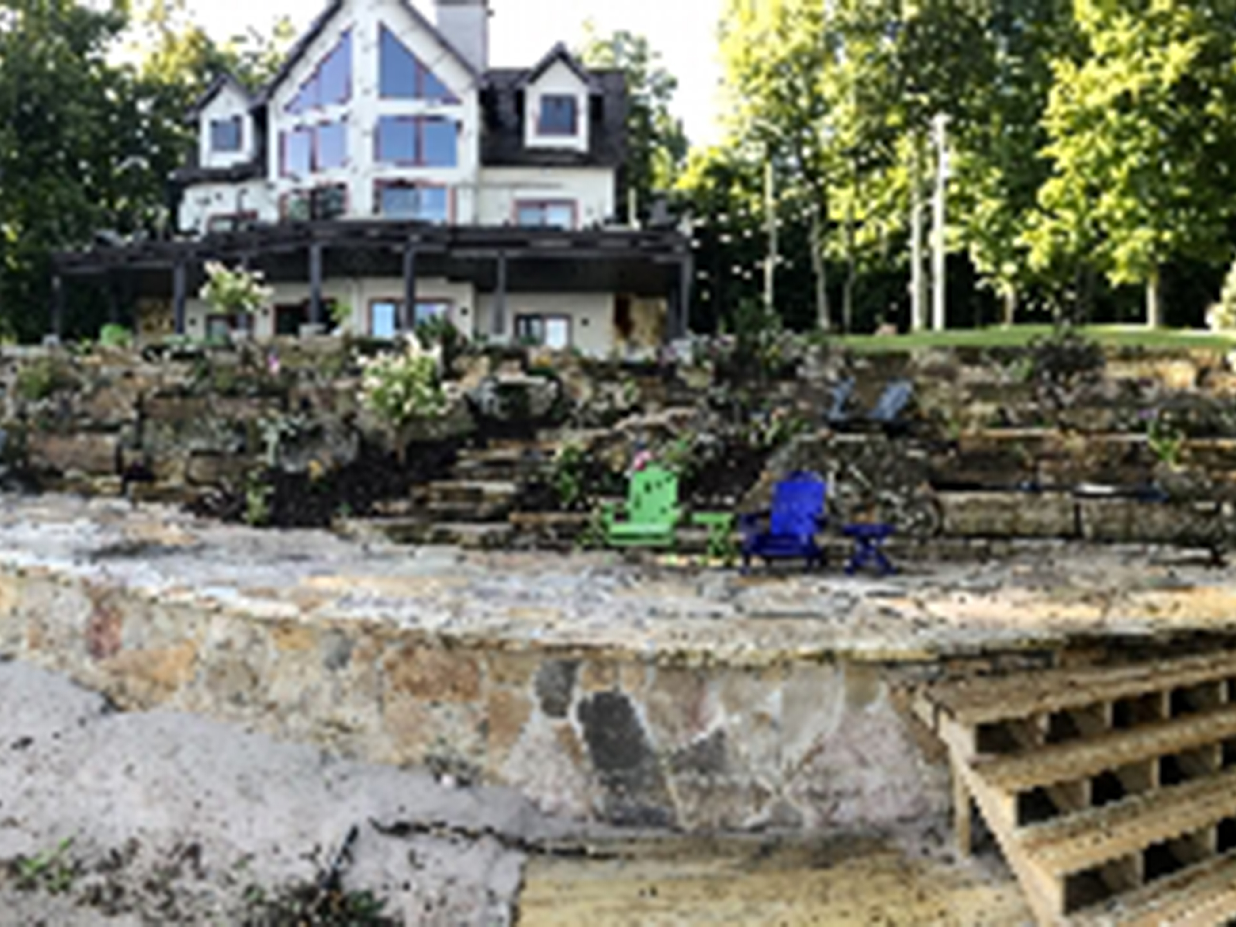Natural Stone Seawall with Stairs, Boulder Terrace, Patio and Gardens