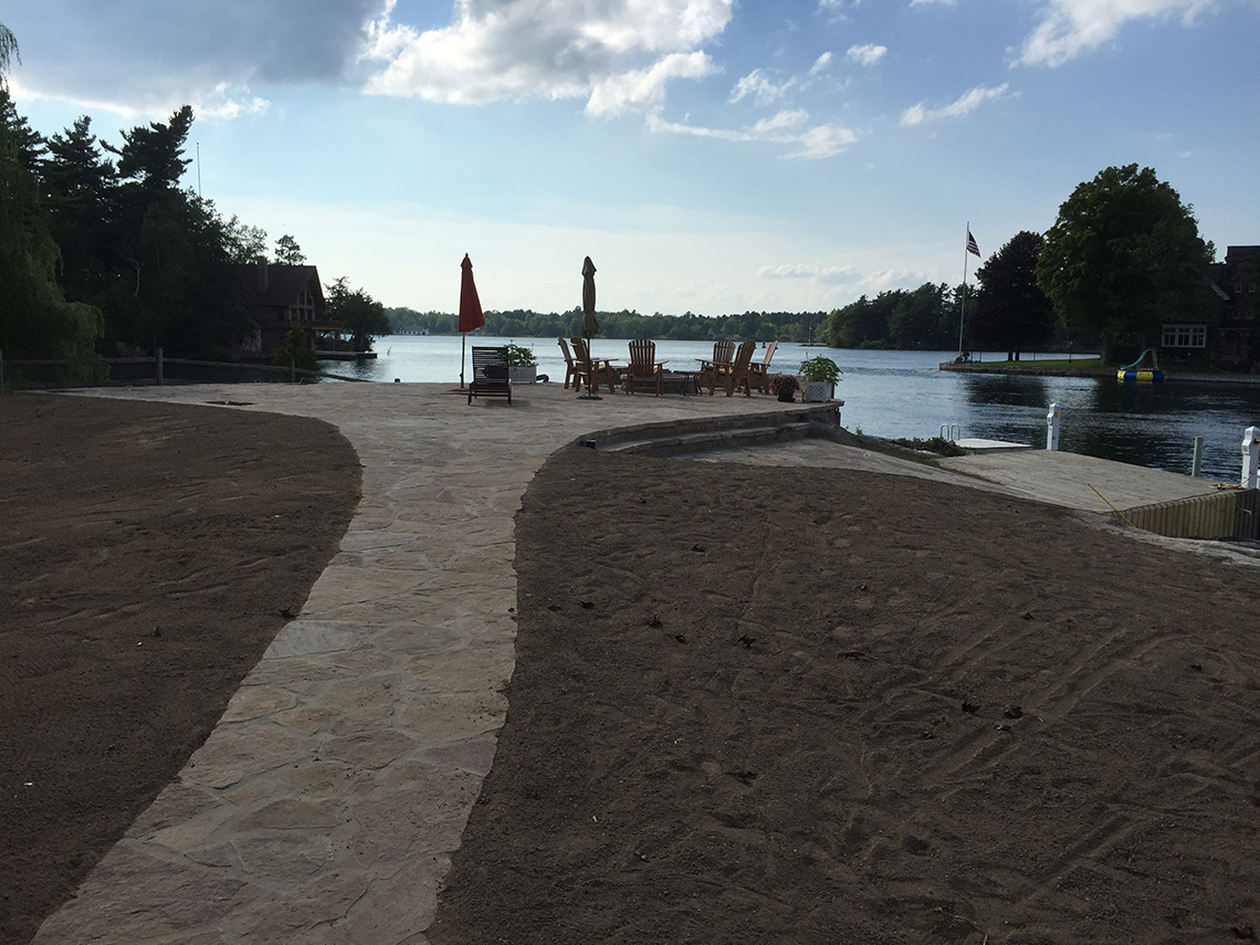 Stone Work Nearly Complete - Lounge Chairs Set to Watch River Traffic